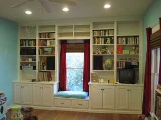Built-in custom cabinetry with a window seat.