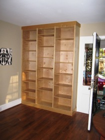 Floor-to-ceiling custom bookcase in white birch.