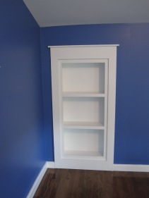 Custom recessed bookcase that holds a secret!