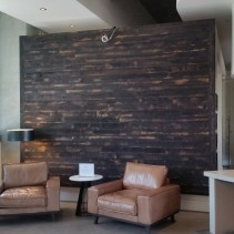 Charred oak accent wall in hotel lobby.